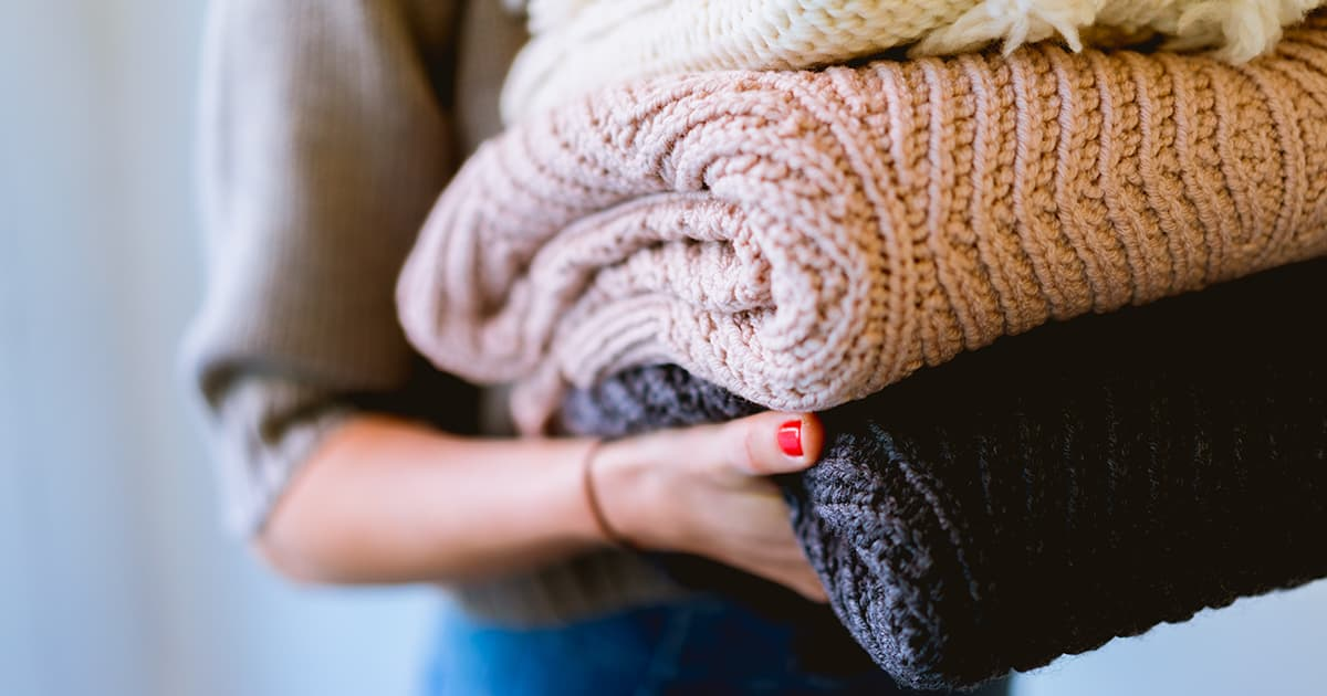 woman's hand carrying blankets